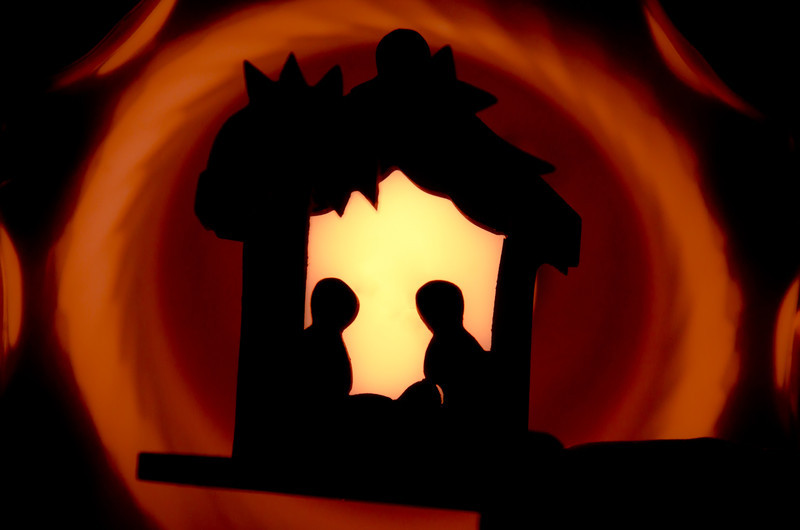 December 25 - Happy Christmas  I spent Christmas at my parents and they had this very little wooden nativty which my Dad held up to a light while I photographed. I'm pretty happy with the result.